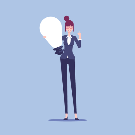 Smiling businesswoman holds a big light bulb as a symbol of a new idea.
