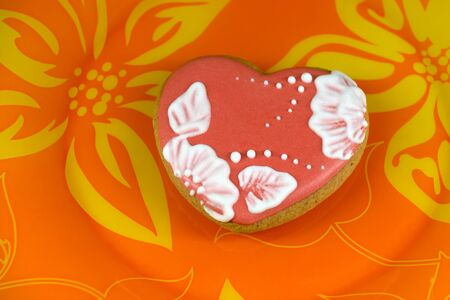 cookie heart on orange background