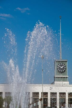 station building on the background of the fountain on a sunny summer day Stok Fotoğraf