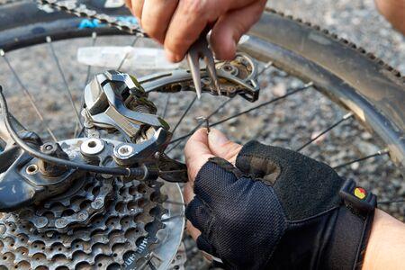 repair of a broken bike in a road situation. closeup photo Stok Fotoğraf - 128308008