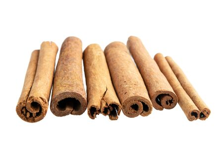 Cinnamon sticks isolated on white background Stok Fotoğraf - 128308009