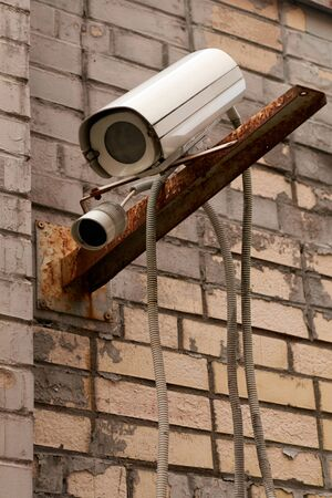outdoor video cameras on a brick wall background