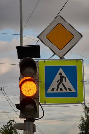 sign main road. pedestrian crossing sign. yellow traffic signal