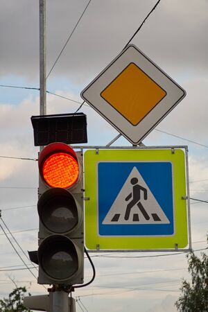 sign main road. pedestrian crossing sign. red traffic signal