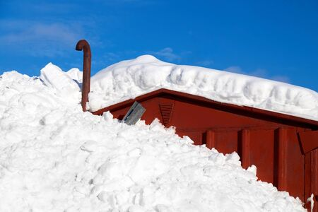 Deep snow covering half a house in countryside Norway, Europe Stok Fotoğraf - 128308068