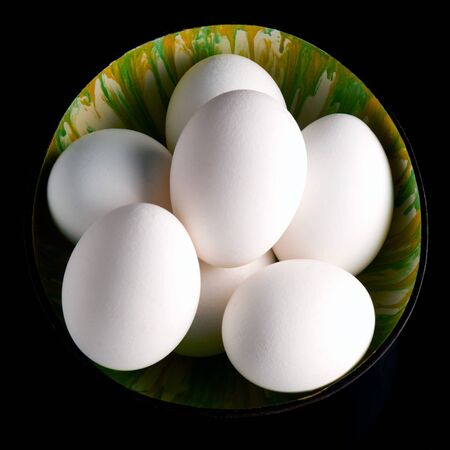 Fresh eggs on the black background