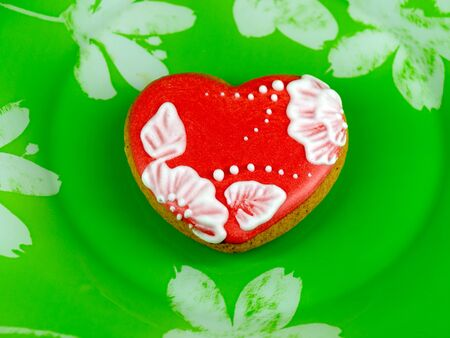 cookie heart on green background