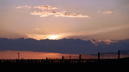 fence against the setting sun. backlit photo Stok Fotoğraf