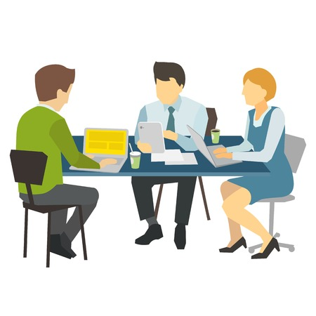 business desk: Three people working at the desk.