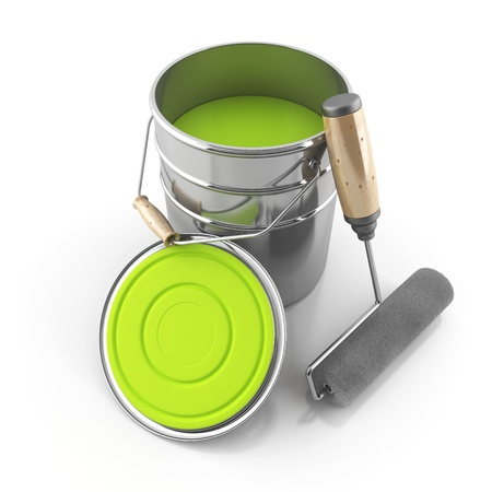 The bright green paint and a roller on an isolated background Imagens