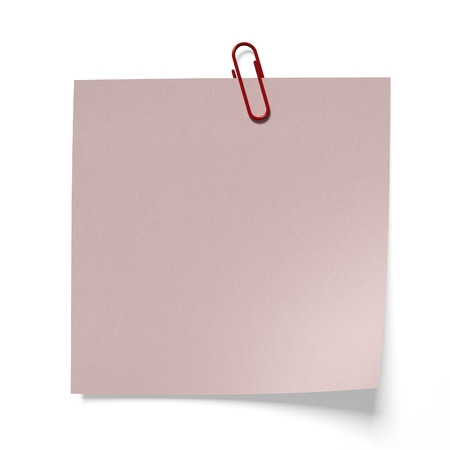 clinch: Red paper clip on a pink paper isolated