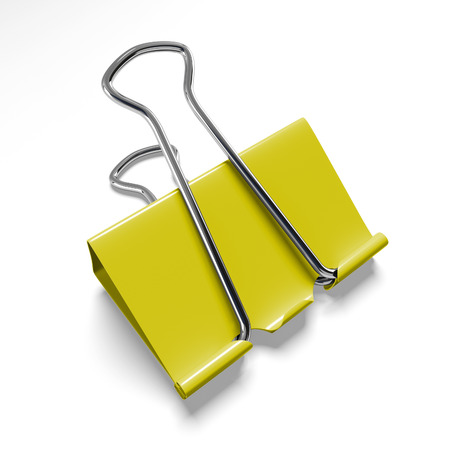 binder clip: Yellow binder clip on a white background isolated Stock Photo