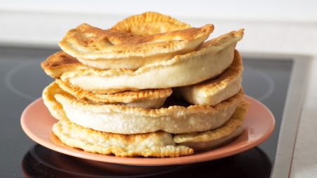 Cheburek fried with meat of beef and pork on a plate Stock Photo - 23435611