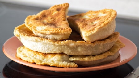Tasty Fried Cheburek with meat on a plate close-up Stock Photo - 23435607