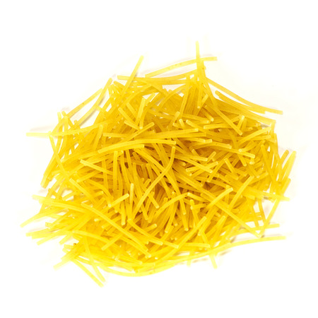 Noodles close-up. Golden yellow dry soup noodles isolated on white background. photo