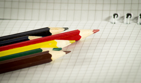 delineate: Spiral notepad with set of color pencils close-up