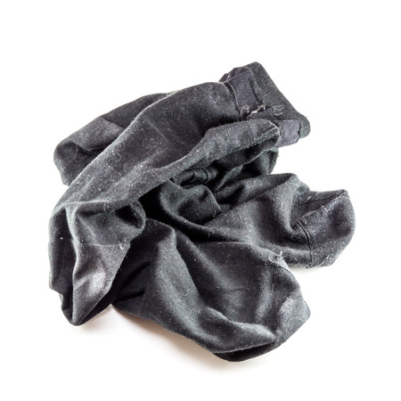 muddy clothes: A pair of dirty socks dropped on the floor