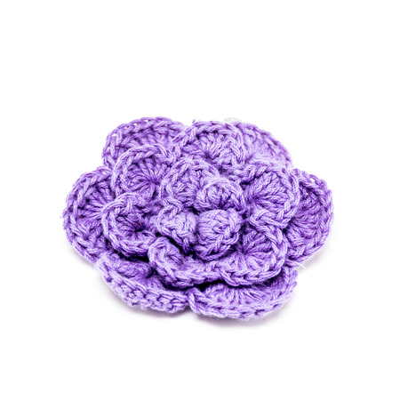 Crochet flower. Knitted flower on a white background. photo
