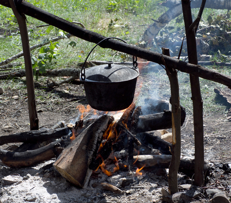 soup kettle: Foot is cooking on the bonfire