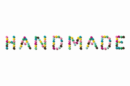 colorful beads: Word HANDMADE made from small colorful beads