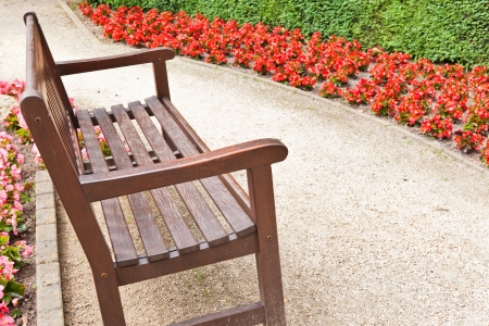Blooming flowers  Gravel Walkway and Wooden Bench Archivio Fotografico