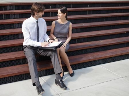 flirting: Business conversation - man and woman.