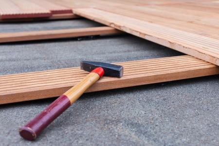 Flooring. Hammer on a floorboard.
