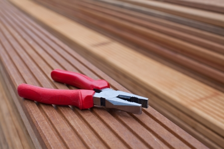 Combination pliers on a floorboard
