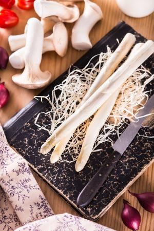 Fresh cut white asparagus on wooden table