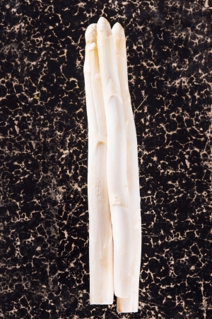 White asparagus on dark background Archivio Fotografico