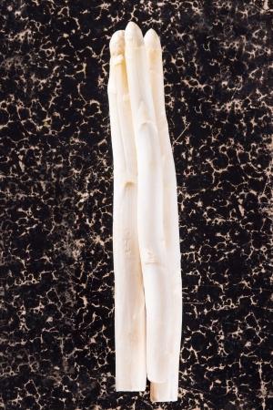 White asparagus on dark background Standard-Bild