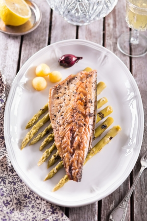 Fish fillet served with spargel potatoes and lemon