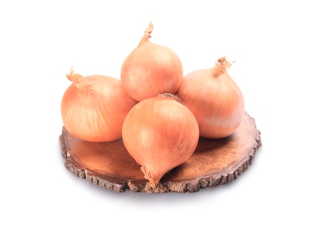onions on a wooden tray