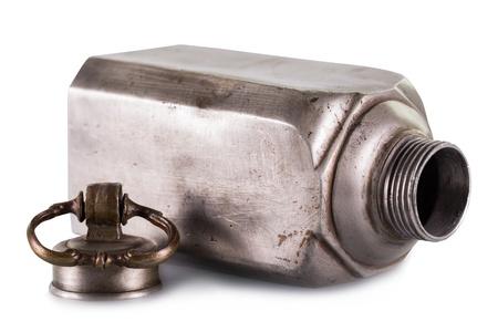 Old vintage metal bottle on a white background