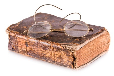 Old book and glasses isolated on a white background Standard-Bild