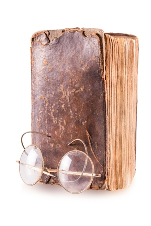 Old book and glasses isolated on a white background Archivio Fotografico