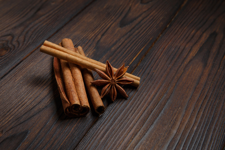 mulled wine spice: Star anise and cinnamon sticks on wood background