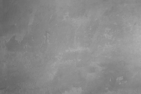 full of holes: the gray surface of a concrete slab as a background Stock Photo