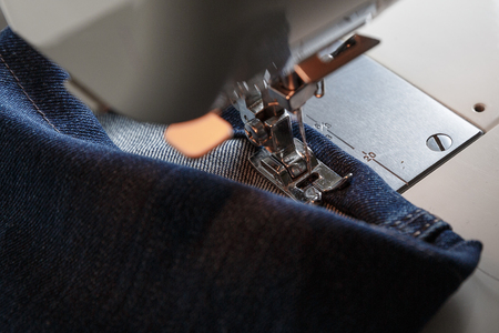 stitching machine: Blue jeans sewing on the sewing machine