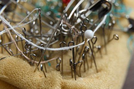 pinhead: Old pin cushion with sewing pins macro