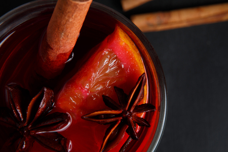Mulled wine on the old dark background