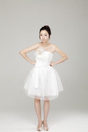 Lovely girl dressed in white short dress