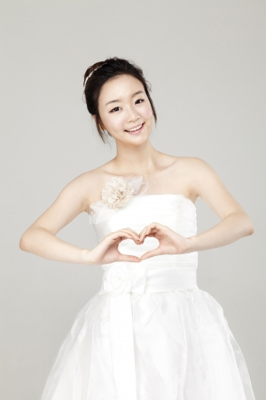 Lovely girl dressed in white short dress photo