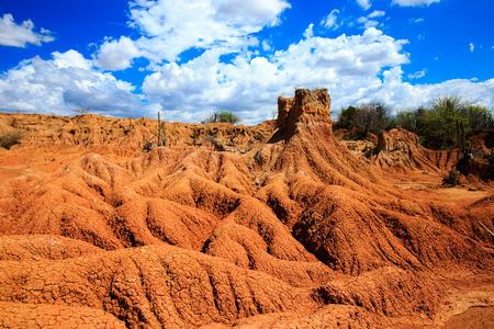 huila: patterns in red desert, tatacoa desert, columbia, latin america, clouds and sand, red sand in desert Stock Photo