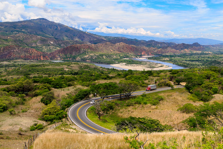a road in red and green mountains, colombia, latin america Stock Photo