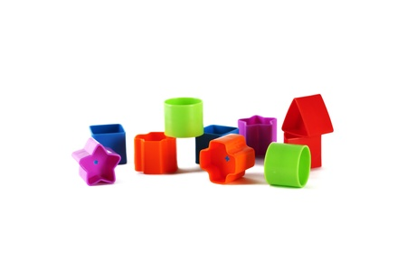 Toy blocks and shapes  on a white background Stock Photo - 12192070