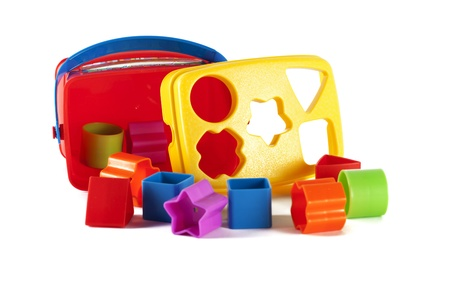 Toy blocks and shapes  on a white background photo