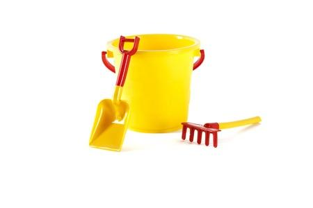 Toy bucket, spade and rake photo
