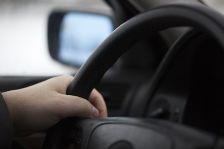 Hand on the steering Stock Photo - 12569193
