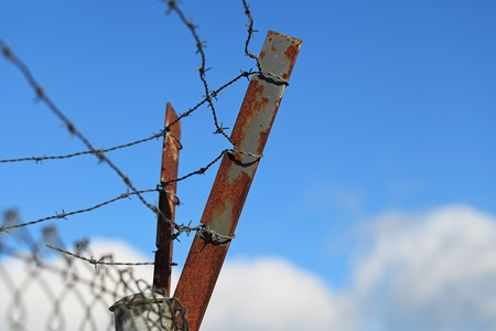 Barbed wire with a blue sky background photo